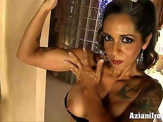 Aziani Iron milf bodybuilder shows her pierced pussy