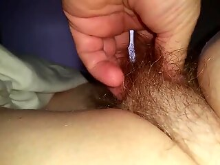 fluffing her soft mated downhairy pussy