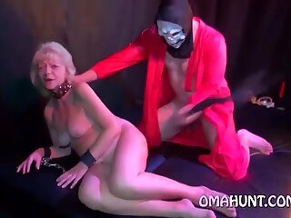 Blonde granny strips and fingers pussy
