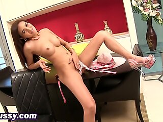 Busty Asian babe shoving dildo in hairy pussy