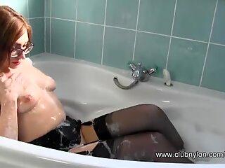 Lesbian slut fucked by pussy toy in bath wearing nylons by horny Milf