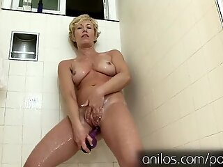 Her own jizm cascading from her mature twat