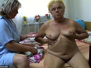Mature woman using dildo on chubby granny