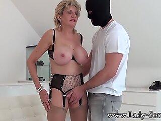 British mature Lady Sonia sucks a masked man