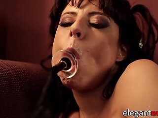 Euro MILF in red lingerie fisting her ass and toying her pus