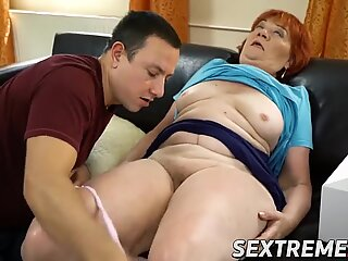 Redhead granny enjoys younger meat and cum in mouth