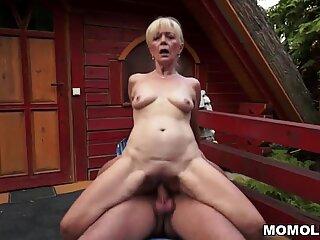 Grandma Szuzanne fucks in a garden