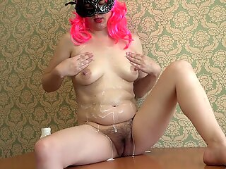 Pregnant milf masturbating with milk, fetish with a hairy pussy and with natural tits on the table.