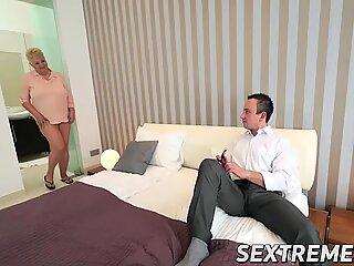 Kinky granny Astrid seduces horny Rob and fucks him wildly