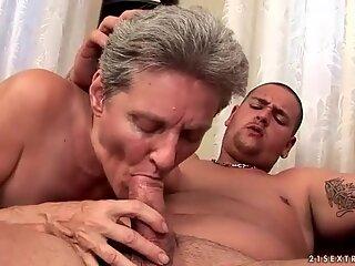 Busty grandma fucking a chubby boy