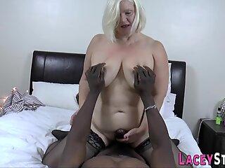 Granny tit fucks and rides big black dick