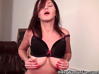 Sexy milf with big titties works her unshaved snatch